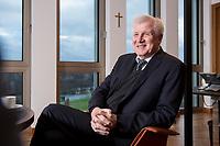 10 DEC 2016, BERLIN/GERMANY:<br /> Horst Seehofer, CSU, Bundesinnenminister, waehrend einem Interview, in seinem Buero, Bundesinnenministerium<br /> IMAGE: 20181210-02-024<br /> KEYWORDS; Büro, Kreuz