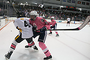 Pittsford forward Austin McGrain hits McQuaid forward Evan MacDougall during the annual Pink the Rink game at RIT's Gene Polisseni Center in Henrietta on Saturday, February 4, 2017.