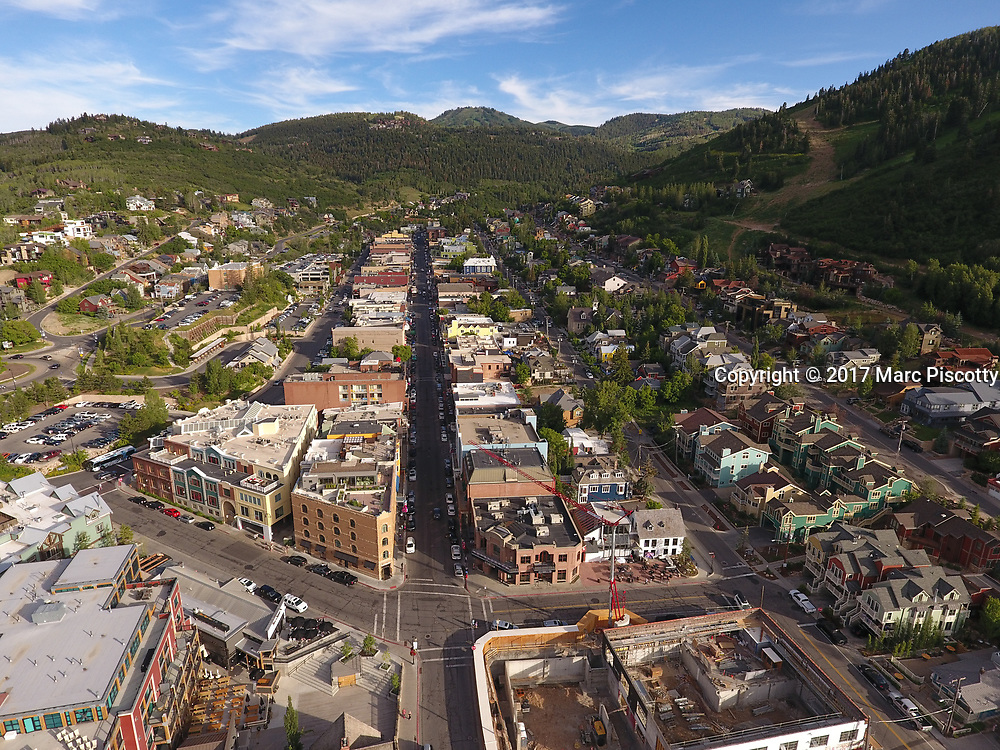 SHOT 7/1/17 7:00:55 PM - Drone photos of Park City, Utah. Park City lies east of Salt Lake City in the western state of Utah. Framed by the craggy Wasatch Range, it's bordered by the Deer Valley Resort and the huge Park City Mountain Resort, both known for their ski slopes. Utah Olympic Park, to the north, hosted the 2002 Winter Olympics and is now predominantly a training facility. In town, Main Street is lined with buildings built during a 19th-century silver mining boom. (Photo by Marc Piscotty / © 2017)