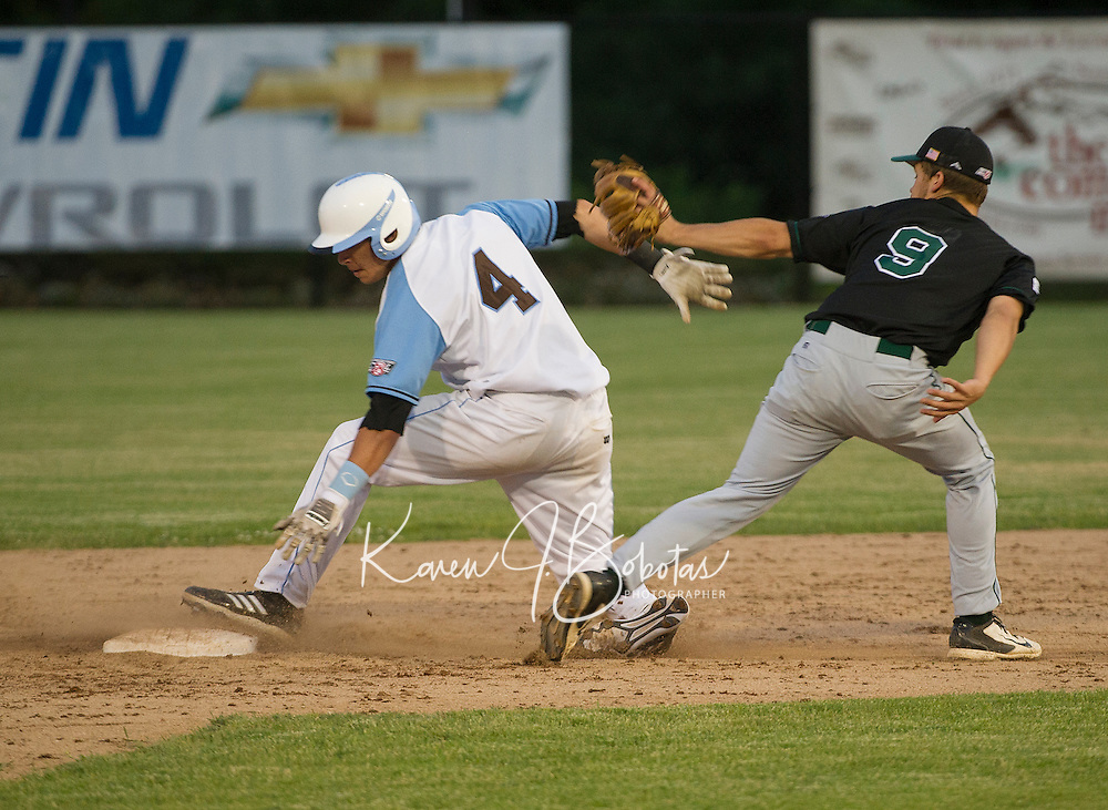 Matt Byrne gets tagged out by Brett Charbonneau during Wednesday nights Muskrats game with the Vermont Mountaineers under the lights at Robbie Mills Field.  (Karen Bobotas/for the Laconia Daily Sun)