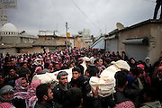 About two thousand inhabitants of Courine, Province of Idlib, Syria, gather for funeral of four men and one woman killed the day before during a full scale military attack on the village.