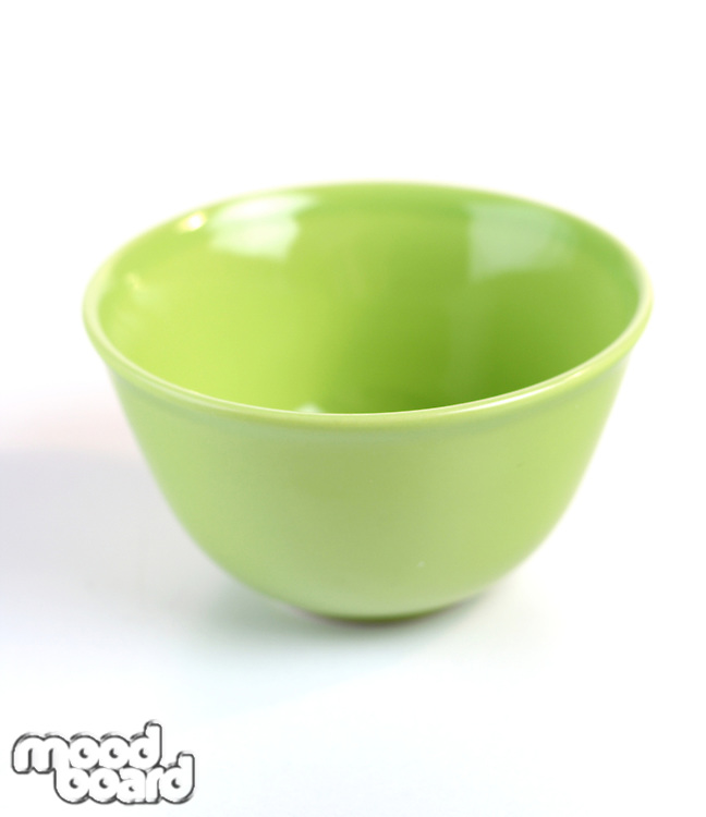 Green bowl on white background - studio shot