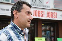 Bulgarian man outside recruitment agency,