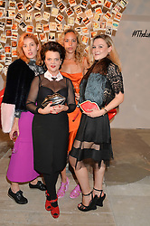 Left to right, PAULA GOLDSTEIN, LULU GUINNESS, PHOEBE COLLINGS JAMES and AMBER ATHERTON at the launch of The Lulu Perspective to celebrate 25 years of Lulu Guinness held at 74a Newman Street, London on 13th September 2014.