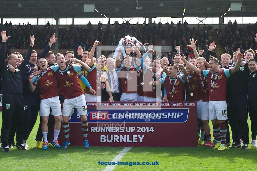 Burnley players celebrate with the trophy after finishing as runners up and being promoted to the Premier League following the Sky Bet Championship match at Turf Moor, Burnley<br /> Picture by Ian Wadkins/Focus Images Ltd +44 7877 568959<br /> 26/04/2014
