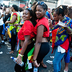 London, UK - 26 August 2013:  two girls dances for the camera during the annual parade at the Notting Hill Carnival.