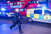More armed officers arrive int eh area - Armed police flood the Oxford Circus area after an incident caused the station to be cleared.