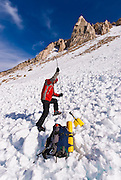 Backcountry skier using avalanche gear, Inyo National Forest, Sierra Nevada Mountains, California USA