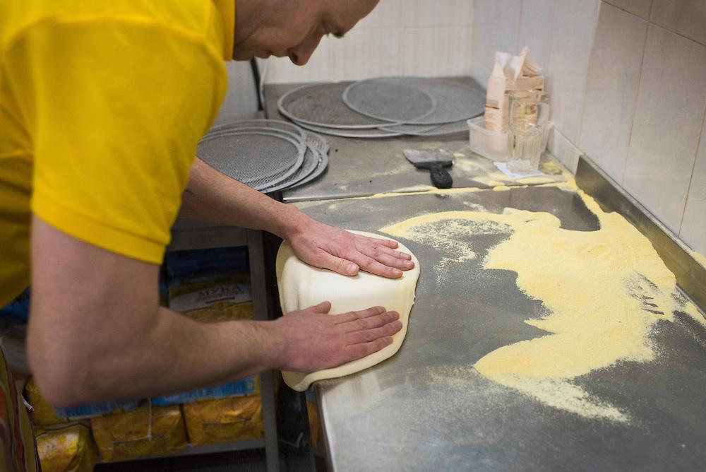 Kirill Deyneka prepares a pizza crust at Veterano Pizza on January 23, 2016 in Kiev, Ukraine. (Pete Kiehart for The New York Times)