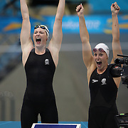 Cate Campbell (left)  and Alicia Coutts celebrate the Australian team winning the gold medal in the women's 4 x 100m freestyle relay final during the swimming finals at the Aquatic Centre at Olympic Park, Stratford during the London 2012 Olympic games. London, UK. 28th July 2012. Photo Tim Clayton