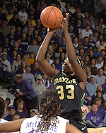 Baylor forward Sophia Young (33) scores two of her game high 33 points over Kansas State's Twiggy McIntyre (lower right), during the first half at Bramlage Coliseum in Manhattan, Kansas, February 25, 2006. The 10 ranked Lady Bears defeated K-State 79-70.
