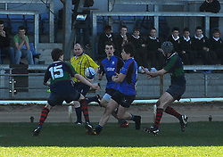 Rice College's Dwayne Corcoran passes to Ruairi Ludden who raced in for Westport's 1st try...Pic Conor McKeown