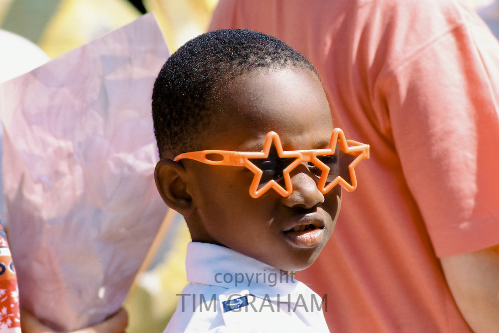 Young boy in jazzy sunglasses in Los Angeles, California, USA