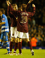 Photo: Chris Ratcliffe.<br />Arsenal v Reading. Carling Cup. 29/11/2005.<br />Arturo Lupoli and Sebastian Larsson of Arsenal celebrate the win