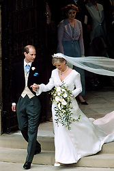 Prince Edward and his wife Sophie Rhys-Jones, who will now be known as the Earl and Countess of Wessex, leave St George's Chapel in Windsor Castle after their wedding.