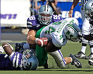 Kansas State defensive end Ian Campbell (98) forces Marshall running back Ahmad Bradshaw (44) to fumble the ball in the first half.  Kansas State recovered the ball, at Bill Snyder Family Stadium in Manhattan, Kansas, September 16, 2006.  The Wildcats beat the Thundering Herd 23-7.
