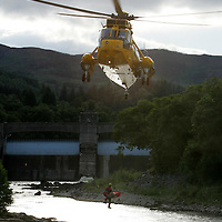 Drowning at Pitlochry Dam...12.07.05<br />The body of a man who drowned in the River Tummel is winched on board the RAF Search & Rescue Sea King helicopter from RAF Lossiemouth.<br />see story by Gordon Currie  07710 462605<br />Picture by Graeme Hart.<br />Copyright Perthshire Picture Agency<br />Tel: 01738 623350  Mobile: 07990 594431
