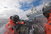 "Sea Shepherd crew in an inflatable fast boat, armed with bottles of rotten butter, are doused by sea spray and water cannons from Japanese harpoon ship, the Yushin Maru No. 1, on Thursday, Feb. 5, 2009 during a confrontation in Antarctica's Ross Sea.  The whaling fleet reported a final tally of 679 minke whales and one fin whale caught during this season's five-month effort, falling short of its goal of 935 minkes and 50 fins.  Officials blamed poor weather and ""interference by protesters"". (Photo by Adam Lau)"