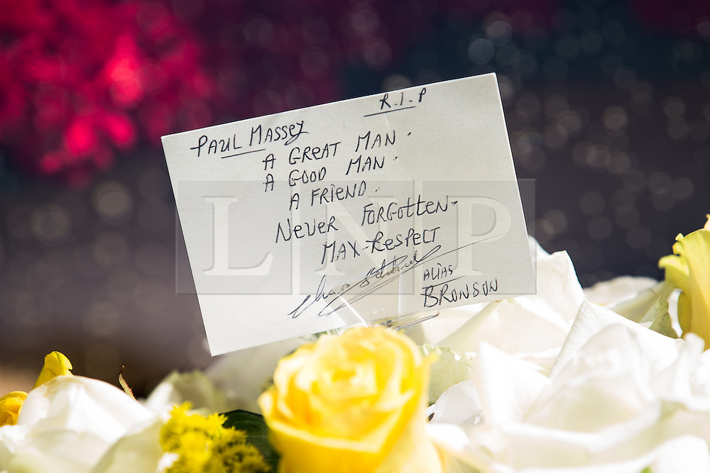 """© Licensed to London News Pictures . 28/08/2015 . Salford , UK . Flowers and tribute on one of the hearses signed """" Max Respect """" and """" Alias Bronson """" . The funeral of Paul Massey at St Paul's CE Church in Salford . Massey , known as Salford's """" Mr Big """" , was shot dead at his home in Salford last month . Photo credit : Joel Goodman/LNP"""