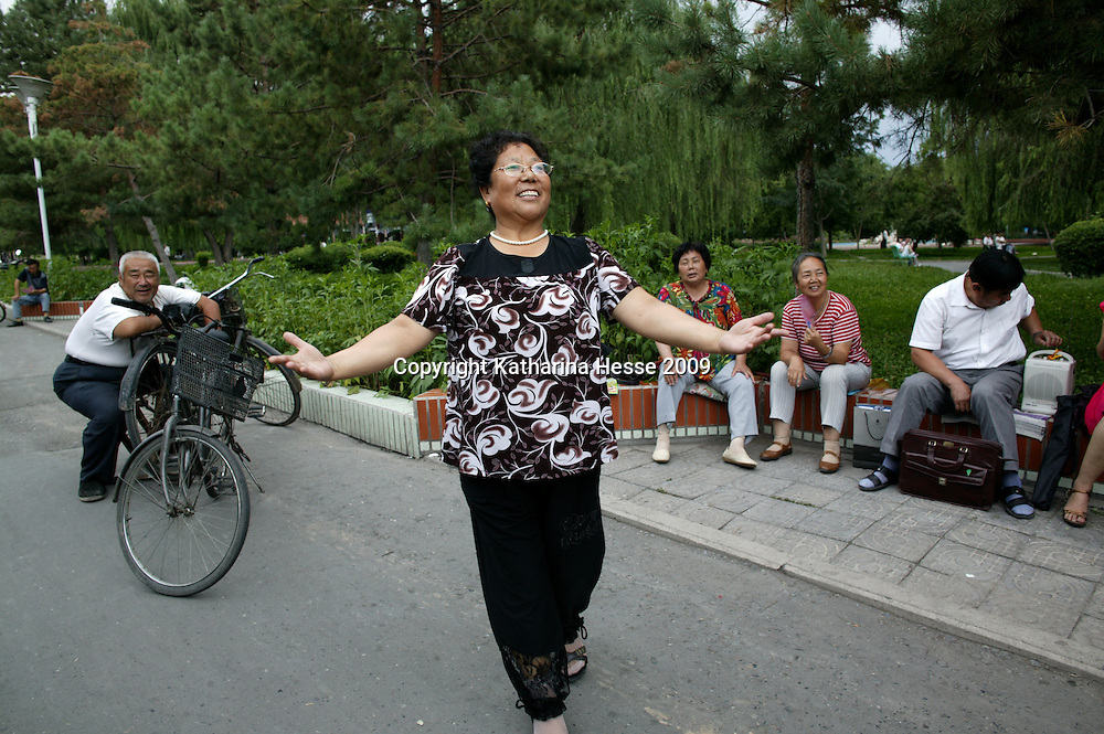 "SHIHEZI, JULY-16 :Yue Caiying had trained to be a nurse in Gansu province but after arriving in Shihezi, worked cleaning streets and scouring toilets. ""I was a model worker, which made me very happy,"" she said."