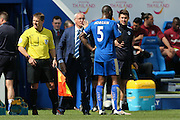 Leicester City Manager Claudio Ranieri  has a harsh word with Leicester City defender Wes Morgan (5)  after Leicester City forward Jamie Vardy (9) scores a goal and celebrates to make the score 1-0 during the Barclays Premier League match between Leicester City and West Ham United at the King Power Stadium, Leicester, England on 17 April 2016. Photo by Simon Davies.