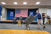 Workers remove chairs after Republican presidential candidate Jeb Bush (FL) held a campaign event at the Colby Sawyer College in New London, NH. ahead of the primaries.