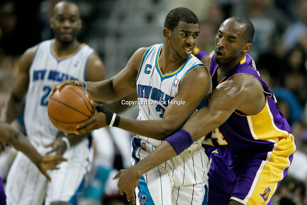 April 24, 2011; New Orleans, LA, USA; New Orleans Hornets point guard Chris Paul (3) is guarded by Los Angeles Lakers shooting guard Kobe Bryant (24) during the second quarter in game four of the first round of the 2011 NBA playoffs at the New Orleans Arena.    Mandatory Credit: Derick E. Hingle