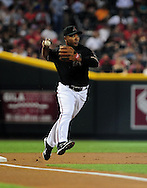 Jun. 18 2011; Phoenix, AZ, USA; Arizona Diamondbacks infielder Melvin Mora (4) throws the ball against the Chicago White Sox at Chase Field. The White Sox defeated the Diamondbacks 6-2. Mandatory Credit: Jennifer Stewart-US PRESSWIRE.