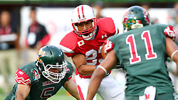 15.07.2011, Ernst Happel Stadion, Wien, AUT, American Football WM 2011, Japan (JAP) vs Mexico (MEX), im Bild Valdez Jorge enrique (Mexico, #5, LB) and Jaimes Luis felipe (Mexico, #11, SS) tries to stop Ken Shimizu (Japan, #83, WR)  // during the American Football World Championship 2011 game, Japan vs Mexico, at Ernst Happel Stadion, Wien, 2011-07-15, EXPA Pictures © 2011, PhotoCredit: EXPA/ T. Haumer