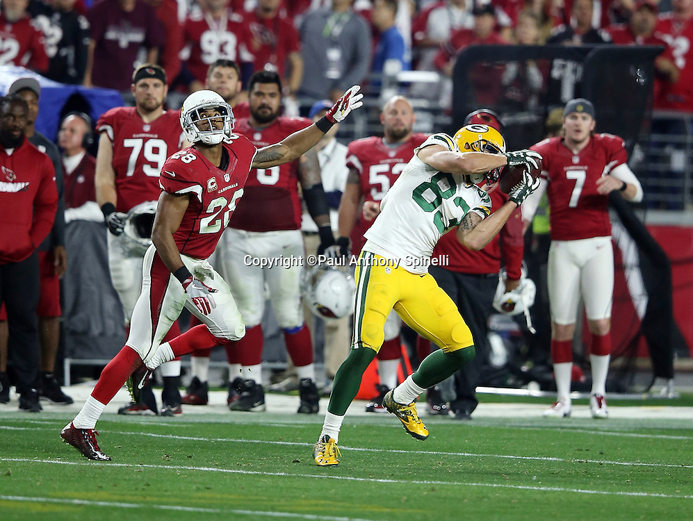Green Bay Packers wide receiver Jeff Janis (83) is covered by Arizona Cardinals cornerback Justin Bethel (28) as he catches a 60 yard pass for a first down at the Arizona Cardinals 36 yard line on a fourth down and 20 yards to go with less than one minute left in the fourth quarter during the NFL NFC Divisional round playoff football game against the Arizona Cardinals on Saturday, Jan. 16, 2016 in Glendale, Ariz. The Cardinals won the game in overtime 26-20. (©Paul Anthony Spinelli)