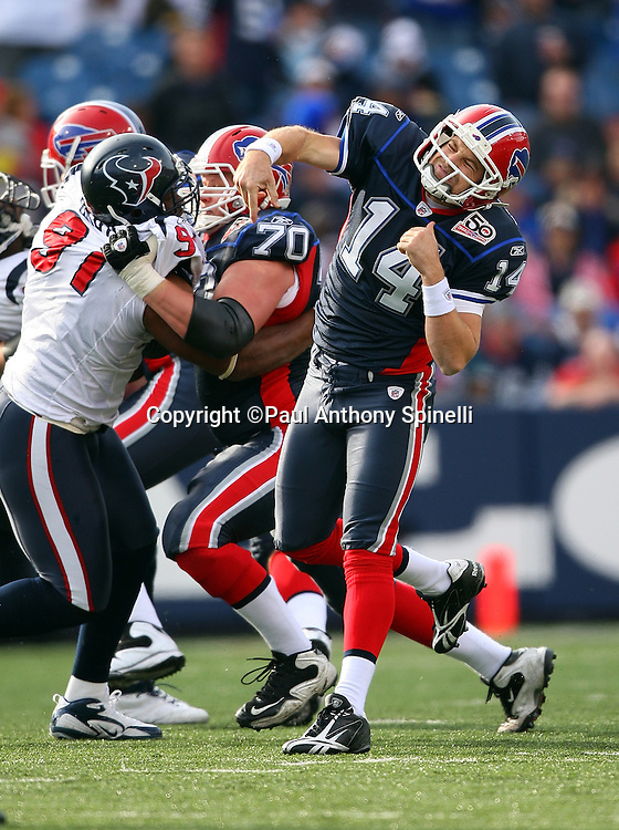Buffalo Bills quarterback Ryan Fitzpatrick (14) gets ready to throw a pass despite pressure from Houston Texans defensive tackle Amobi Okoye (91) during the NFL football game against the Houston Texans, November 1, 2009 in Orchard Park, New York. The Texans won the game 31-10. (©Paul Anthony Spinelli)