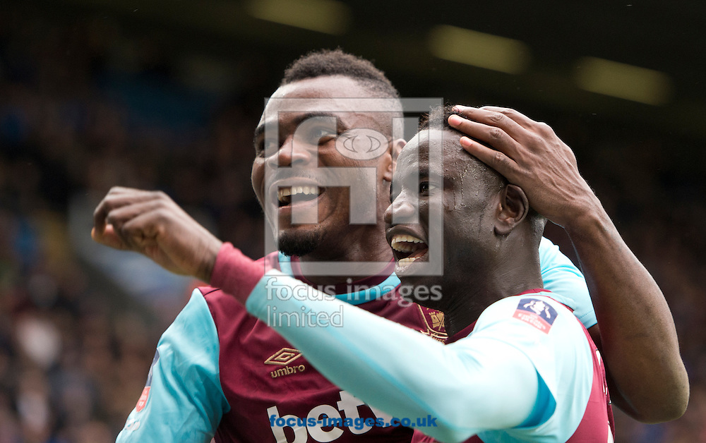 West Ham United team-mates Emmanuel Emenike (left) and Cheikhou Kouyate (right) celebrate after their team take a 3-1 lead during the FA Cup match at Ewood Park, Blackburn<br /> Picture by Russell Hart/Focus Images Ltd 07791 688 420<br /> 21/02/2016