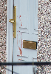 ©Licensed to London News Pictures 26/02/2020<br /> Croydon, UK. What looks like a blood hand print on the front door of a property. A 24 year old man has been stabbed to death in Croydon, South East London over night. Police were called to the scene at 12.15am. The man was pronounced dead at the scene no arrests have been made. A police cordon is in place with forensic officers coming and going to a nearby property. Photo credit: Grant Falvey/LNP