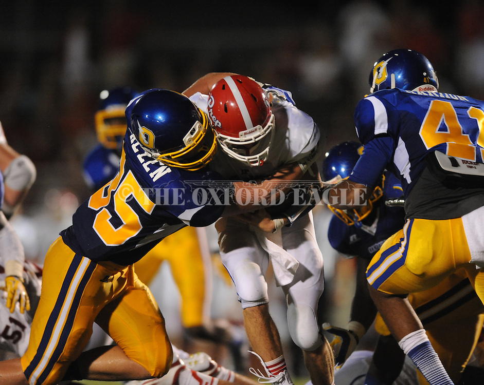 Oxford High's Thomas Allen (35) tackles Jackson Prep's Gene Wood (10) in Oxford, Miss. on Friday, August 23, 2013. Oxford won 32-20.