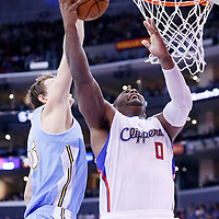 15 April 2014: Los Angeles Clippers forward Glen Davis (0) is blocked by Denver Nuggets center Timofey Mozgov (25) during the Los Angeles Clippers 117-105 victory over the Denver Nuggets at the Staples Center, Los Angeles, California, USA.