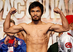 Nov 13, 2009; Las Vegas, NV, USA; Manny Pacquiao at the weigh-in for his 12 round bout against Miguel Cotto at the MGM Grand Garden Arena in Las Vegas, Nevada.  Mandatory Credit: Ed Mulholland
