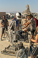 This robot was unquestionably one of my favorite things at Burning Man 2018. It's head moves around, it talks and moves around interacting with Burners and other robots!
