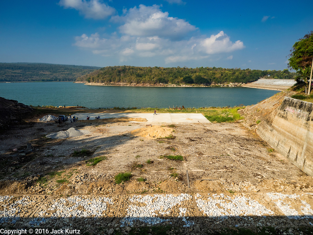 21 JANUARY 2016 - KHLONG PHAI, NAKHON RATCHASIMA, THAILAND: A dry spillway at Lam Takhong Dam in Nakhon Ratchasima province. The dam is only 30 percent of its capacity and farmers downstream have been told they can't draw irrigation water from the dam.  The drought gripping Thailand was not broken during the rainy season. Because of the Pacific El Nino weather pattern, the rainy season was lighter than usual and many communities in Thailand, especially in northeastern and central Thailand, are still in drought like conditions. Some communities, like Si Liam, in Buri Ram, are running out of water for domestic consumption and residents are traveling miles every day to get water or they buy to from water trucks that occasionally come to the community. The Thai government has told farmers that can't plant a second rice crop (Thai farmers usually get two rice crops a year from their paddies). The government is also considering diverting water from the Mekong and Salaween Rivers, on Thailand's borders to meet domestic needs but Thailand's downstream neighbors object to that because it could leave them short of water.     PHOTO BY JACK KURTZ