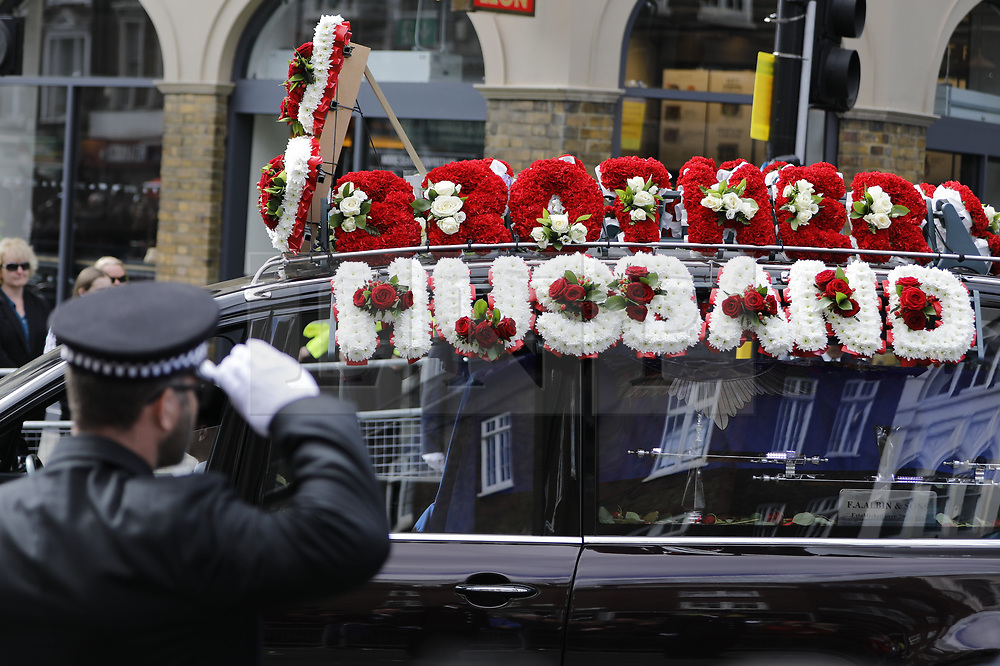 © Licensed to London News Pictures. 10/04/2017. London, UK. The funeral of policeman Keith Palmer at Southwark Cathedral in London ahead of his funeral. PC Palmer was murdered just inside the gate by Westminster attacker Khalid Masood - an attack in which he also killed four people on Westminster Bridge.  Photo credit: Tolga Akmen/LNP