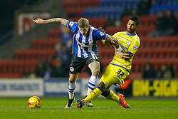 James McClean of Wigan is challenged by Lewis McGugan of Sheffield Wednesday - Photo mandatory by-line: Rogan Thomson/JMP - 07966 386802 - 30/12/2014 - SPORT - FOOTBALL - Wigan, England - DW Stadium - Wigan Athletic v Sheffield Wednesday - Sky Bet Championship.