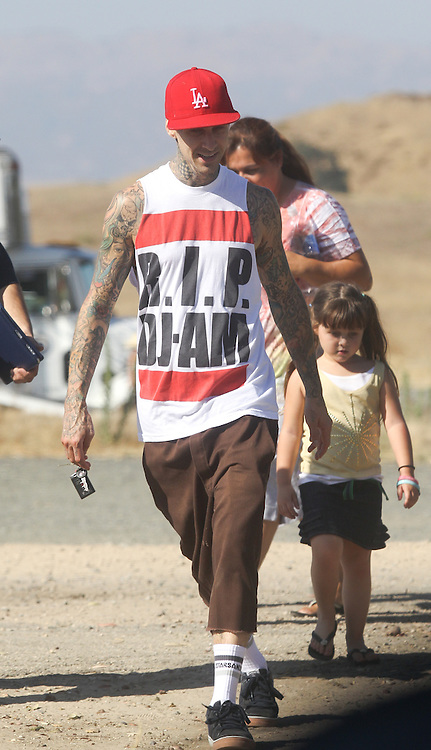 """July 20th 2010  Calabasas, CA. ***EXCLUSIVE*** Musician Travis Barker wears a shirt that says """"R.I.P. DJ AM"""" . Travis Barker and DJ Adam Goldstein were best friends and survived a plane crash together. One year after the crash DJ AM was found dead in his NYC apartment from """"acute intoxication"""" . Travis is photographed with his son Landon and daughter Atiana as they leave a music video set for Eminem which was filming in  Calabasas where Travis resides. Eminem was performing in a field of long grass for his """"The Way You Lie""""  music video when Barker and his kids arrived to visit. On the 2010 album 'Recovery', Eminem pays a personal tribute to DJ AM with the lyric 'Rest in Peace to DJ AM Cause I know what its like I struggle with this shit every single day' on the track 'Talkin to Myself'. Photo by Danny Mayer/ Eric Ford/ On Location News 818-613-3955 info@onlocationnews.com"""