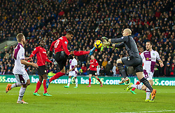 CARDIFF, WALES - Tuesday, February 11, 2014: Cardiff City's Fraizer Campbell in action against Aston Villa'a goalkeeper Brad Guzan during the Premiership match at the Cardiff City Stadium. (Pic by David Rawcliffe/Propaganda)