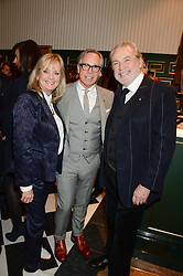 Left to right, TWIGGY, TOMMY HILFIGER and LEIGH LAWSON at the Kent and Curwen London Flagship Launch, Saville Row, London on 6th November 2013.