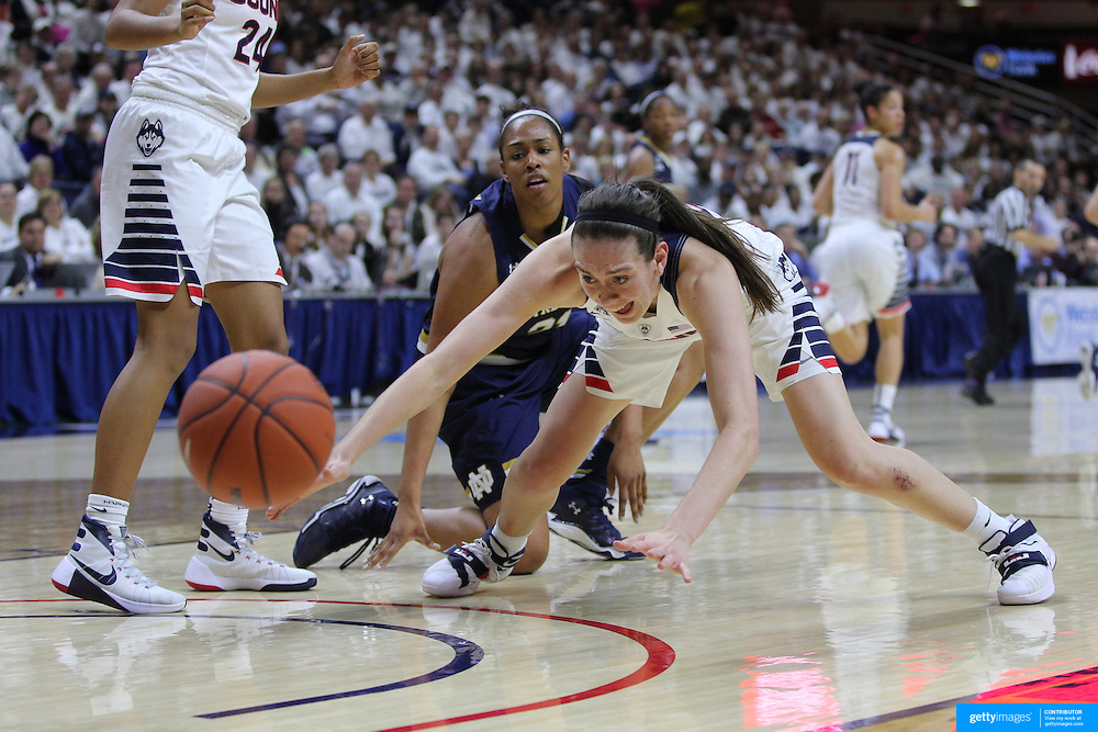 Breanna Stewart, UConn, challenges for a loose ball watched by Kristina Nelson, Notre Dame, during the Notre Dame Vs UConn Women's Basketball game at Grampel Pavilion, Storrs, Connecticut, USA. 5th December 2015. Photo Tim Clayton