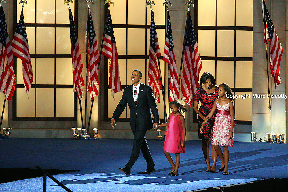 DENVER, CO - Barack Obama takes the stage after his speech with his wife Michelle and his two children Natasha (holding his hand), 7, and Malia Ann (with MIchelle), 10, Malia Ann. Obama addressed the more than 70,000 people that gathered to hear him accept the Democratic Party nomination on Thursday August 28, 2008 at Invesco Field in Denver, Co. on the final night of the 2008 Democratic National Convention. Highlighted speakers on Wednesday evening included Howard Dean, former Governor of Vermont and Chair of the Democratic Party; Al Gore, former Vice President of the United States and the acceptance speech of Barack Obama as the Democratic Party candidate for President...(Photo by Marc Piscotty / © 2008)