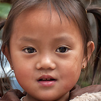 Portrait of a girl i met in a small grocery shop in Nong Khiaw.