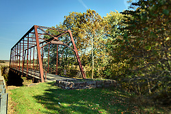 19 October 2015:   Parke County Indiana is the site of the Indiana Covered Bridge Festival every October.<br /> <br /> Bridgeton Iron Bridge is not a covered bridge but a nice example of a Iron truss bridge.  This bridge sits east of Bridgeton and spans the Big Raccoon Creek.  It was built in 1892 by Whipple Through Truss Construction.  It was built in 1892 and bypassed 99 years later in 1991.  It's span measures 175 feet.<br /> <br /> This image was produced in part utilizing High Dynamic Range (HDR) processes.  It should not be used editorially without being listed as an illustration or with a disclaimer.  It may or may not be an accurate representation of the scene as originally photographed and the finished image is the creation of the photographer.