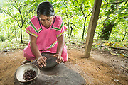 A Ngäbe woman grinds cacao beans into a paste. Oreba Chocolate Nativo, Bocas del Toro, Panama