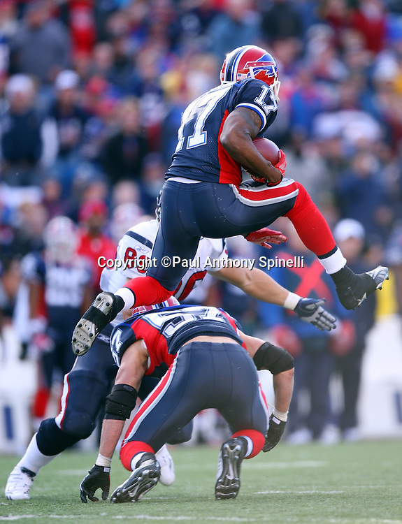 Buffalo Bills wide receiver Justin Jenkins (17) tries to leap over a tackle attempt on a failed fake punt during the fourth quarter of the NFL football game against the Houston Texans, November 1, 2009 in Orchard Park, New York. The Texans won the game 31-10. (©Paul Anthony Spinelli)