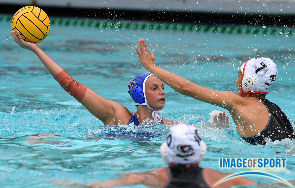 UCLA Bruins attacker Bronte Halligan (25) is defended by Pacific Tigers attacker Vikoria Tamas (7) during an NCAA college women's water polo quarterfinal game in Los Angeles, Friday, May 11, 2018. UCLA defeated Pacific, 8-4.
